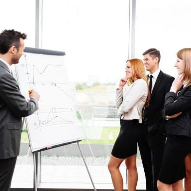 business concept - business people working with flipchart in office